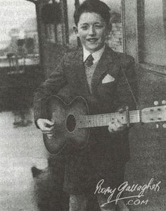 Rory with guitar  Rory, age 9, gets an acoustic guitar as a gift from his parents and teaches himself to play.   Story - Rory Gallagher | The Official Website