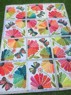 I finished a quilt that I have been working on for the last 11 months. Yeah! I saw it last year at the Minnesota quilt show in the Fiberworks Quilt Shop booth. I debated for quite a while over i…