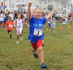 Colin Rubin, 7, of Jackson, raises his hand in victory during the six and seven year old children's race. Runners converge in Long Branch for the 10th Annual Pier House 5K road race, the concluding race for the Jersey Shore Golden Grand Prix, sponsored by McLoone's, on Labor Day, Monday, September 2, 2013. LONG BRANCH, NJ - STAFF PHOTOGRAPHER/MARY FRANK/ASBURY PARK PRESS - ASB 0903 PIER HOUSE 5K