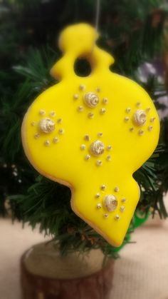 Yellow Christmas Ornament Sugar Cookie.  Crisp, buttery and individually hand decorated so no two are exactly alike.
