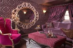 Boudoir style Victorian sitting room - mixed with a variety of pinks and purples, plush posh velvets with a touch of animal print. Fancy ornate mirrors and filigree patterns are a must!