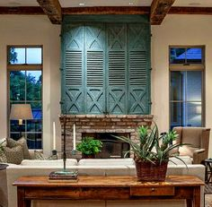Those shutters over the fireplace are FABULOUS!! Interior design and photo by Lucas/Eilers.