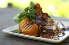 Seasonal Grilled Deliciousness - Grilled Peach, Prosciutto, Teenie Arugula, Agave Roasted Walnuts, Goat Cheese & Balsamic Reduction