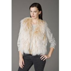 """Ugg Marin Vest natural Product Details Up your fashion factor with the stylish Marin Vest from UGG Australia. Made of curly Mongolian lamb fur with a plush 4"""" pile, this sassy vest offers equal parts warmth and flair, making it the ultimate fall/winter find. Inside, you'll find silky starburst-logo lining with lambskin trim, and 2 twisted leather tassels hang on the edge for fastening on extra-cool days. 2 lined pockets complete this contemporary design. 19"""" long. Imported. XS/S= (0, 2, 4)…"""