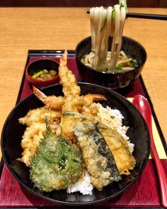 Craving Tempura on this Fryday!  Enjoyed this super crispy medley of prawns shiso potatoes and eggplant tempura over a bowl of rice with a side of delicious udon noodles and pickles. It was a quick inexpensive and tasty meal  at the bustling Kyoto Station.