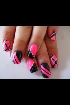 Pretty pink and black nail art. Different design on every finger. Very creative
