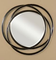 This unusual mirror features a frame made of three entwined circles with a matte black finish with silver leaf inner and outer edges. Mirror has a generous 1 bevel. W X 48 H X 1 D (in) Diy Vanity Mirror, Round Wall Mirror, Wall Mounted Mirror, Beveled Mirror, Black Mirror, Round Mirrors, Mirror Glass, Uttermost Mirrors, Mirrors Wayfair
