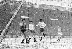 9th December 1967. At Maine Road, Manchester City forward, Colin Bell blasted the Sky Blue's first goal, during their Football League Division One game with Tottenham Hotspur. Spurs goalkeeper, Jennings, stands transfixed in the snow. Manchester City won 4-1.