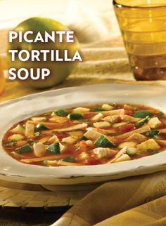 This spicy Picante Tortilla Soup recipe features prepared picante sauce mixed with Swanson Chicken Broth, zucchini, tortilla strips and chopped fresh cilantro. Make this for your next Mexican dinner night!