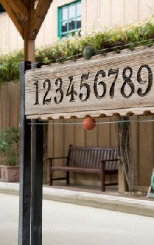 backyard project A Bocce Scoreboard - this sight has rules for playing on a court also.