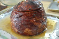 Recreating a Baked Honey Ham! Created by Family Circle Magazine.   Basically this uses a standard spiral cut ham and then dresses it up in a nice honey fashion.
