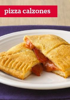Pizza Calzones – The calzone. A cheesy, saucy, pepperoni-filled slice of heaven — without the pizza drip.