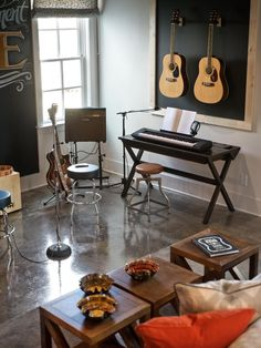 A space designed to encourage musical inspiration boasts the homes most artistic chalkboard wall.