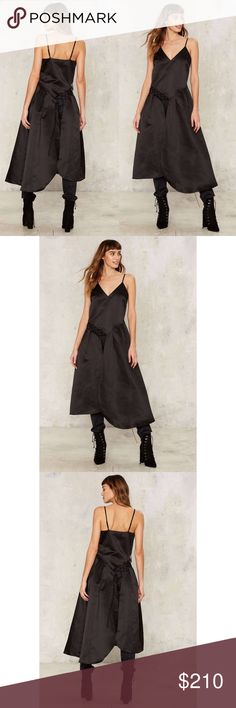 NEW♡ ɴᴀsᴛʏ ɢᴀʟᴮᴱˢᵀ ᴾᴬᴿᵀ ᴹᴬˣᴵ ᵀᴼᴾ[XS]• NEW • \\Nasty Gal// Best Part Maxi Top :: Size [XS] ::: Satin//silk blend ::: Lace up corset style done right :: Is in the great divide. The Best Part Top comes in black and features a V-neckline maxi silhouette, lace-up detailing at side, and splits at front and back. Nasty Gal Tops Tank Tops