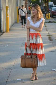 Summer can't come fast enough! Love this... patterned flowy skirt + simple white t-shirt