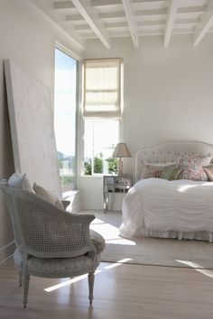 Inspirational bedroom...... Rachel Ashwell, whites and floral pillows