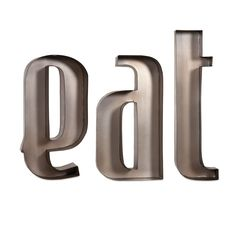 """Turn your kitchen into a more welcoming space with these decorative metal wall letters that keep the focus on mealtime. The brushed iron letters spell out """"eat"""" in a bold, retro font, inviting your family or gusts to sit down and enjoy."""