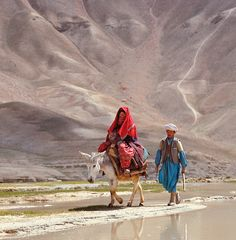 A couple traveling near the Band-e-Amir lakes in Bamiyan, Afghanistan. Photograph by Ric Ergenbright.
