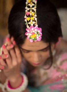 Looking for Floral jewellery mehendi maangtikka? Browse of latest bridal photos, lehenga & jewelry designs, decor ideas, etc. on WedMeGood Gallery. Flower Jewellery For Mehndi, Lehenga Jewellery, Flower Jewelry, Bridal Hair Buns, Haldi Ceremony, Floral Garland, Indian Wedding Decorations, Flower Dresses, Mehendi