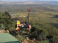 Zip line in Sun City, South Africa.  Over a mile long and speeds can reach 100mph!