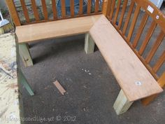 kids corner bench- or a bench for our dining nook - looks like old bed heads with some wood blocks...