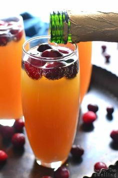 These Cranberry-Orange Mimosas are deliciously sweet and perfect for a celebration! Does anyone else feel like they're in a time warp? I know it's Monday, but with Jorden and the kids home, I really can't keep track! It might have something to do with the fact that we haven't left our house since Christmas....or the fact that there's a winter storm warning for today with 100% chance of snow ALL DAY LONG...(meaning our chances of leaving the house are approximately 0%)....but whatever it is…