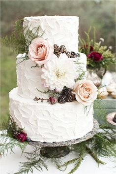 Fall Wedding Cake: a buttercream wedding cake with metallic pine cones and blush roses.