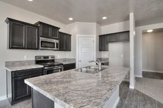 Create contrast in your dream kitchen with dark, twilight cabinets, and light countertops!