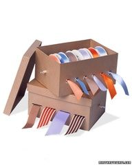 Ribbon storage. Good to use old shoe boxes... Just use spray glue to stick paper neatly to the box, cut slits.