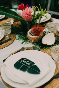a tropical bridal shower tablescape with greenery, tropical blooms, coconuts, proteas, tropical leaves and wicker chargers descriverehair brittniwithni Wedding decorations … Wedding Table Themes, Wedding Favor Table, Beach Wedding Reception, Beach Wedding Favors, Rustic Wedding Decorations, Wedding Ideas, Wedding Cakes, Hawaii Wedding, Decor Wedding