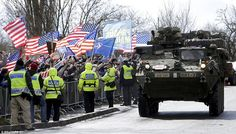 Armored column: Row on row of American firepower rolled through Prague today as Stars and ...
