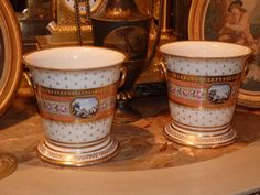 Magnificent pair of planters, Paris manufactory porcelain, end of 18th Century. Nice decor of flowers, pearls, laurel, and small landscapes. For sale on Proantic by Desarnaud.   #planter   #18thcentury  #paris