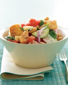 Cubes of country bread, provolone cheese and cannellini beans elevate this refreshing summer salad to main dish status. Prepare it at least two hours in advance to allow the bread to soak up the dressing.