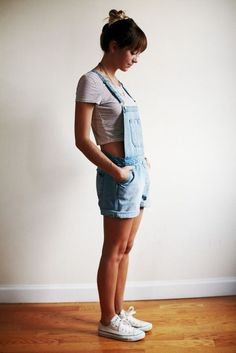 Overall shorts, simple cropped tee, up do, and high top white converse.