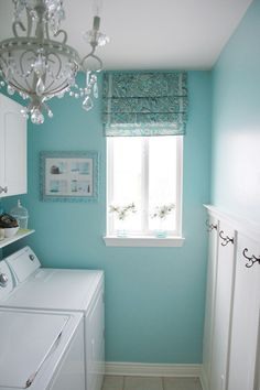 Amazing laundry room. I am in love with this color. This is the exact fabric I envisioned for the cabin,  if I cannot find this fabric I may cry….
