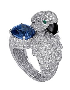 Parrot-motif ring. Platinum, cushion-cut sapphire, emerald eyes, mother-of-pearl beak, diamonds. PHOTO: Vincent Wulveryck © Cartier 2011