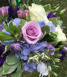 Bridesmaids bouquet of light blue and Lilic flowers