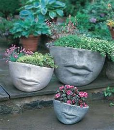 Cement planters with personality, I had to list them because they are so cute