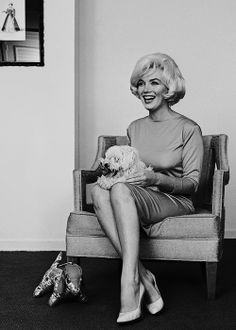 """beauvelvet:  """" """"Marilyn Monroe with her french poodle Maf given to her by Frank Sinatra, 1961.  """" """""""