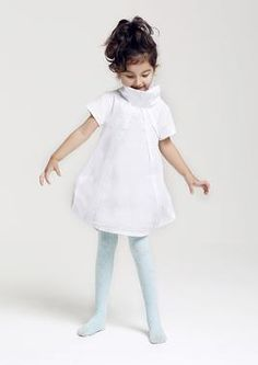 A bright white hue dress is a must have for every girls wardrobe. This unique short sleeves dress has origami-structured panels, with geometric sides, funnel collar with concealed zip fastening, full body lining.