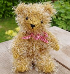 Teddy bear worked in King Cole Tinsel yarn. Digital knitting pattern for this toy available as instant download in my Etsy store. Please see link.