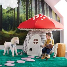 Mushroom Playhouse! I wouldn't fit very well, but I'd sure as hell try! :D Love it