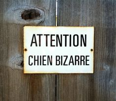 """So in need of this! Vintage French sign: """"Caution Strange Dog."""""""