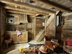 Tiny kitchen and living area in the reclaimed wood tiny house