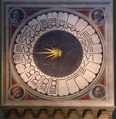 Above the main door is the colossal clock face with   fresco portraits of four Prophets or Evangelists by Paolo Uccello (1443).  This liturgical clock shows the 24 hours of the hora italica (ltalian time),  a period of time ending with sunset at 24 hours. This timetable was   used till the 18th century. This is one of the few clocks from that time,   that still exist and are in working order.