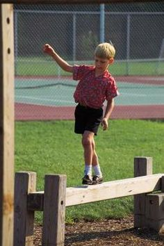 Walking a balance beam requires body, spatial and directional awareness.
