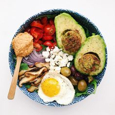 Baked falafel avocado pits!  It's my birthday so I put all of my favorite things in my favorite bowl! {Shiitake mushrooms hummus avocado and falafel}. It's a whole avocado kinda afternoon! by brooklynvegetarian