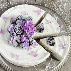 Vegan coconut and vanilla cheesecake with roasted almond and cashew crust topped with fresh blackberries and blueberries.