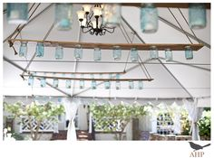 Blue-stained mason jar chandeliers. @mollie wren Kate ;)