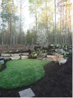 """Yard Crashers """"Backyard Boulder Bash"""" used REALLY nice artificial turf to create a play space for the home owner's little girl. Bet its great for pets too! Yard Crashers, Outdoor Spaces, Outdoor Decor, Artificial Turf, Diy Network, Yard Ideas, Bouldering, Backyard Landscaping, Grandkids"""